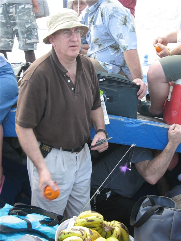 John handing out fruit for us to eat while on the boat