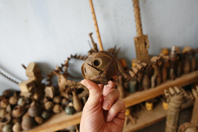 Bombies (sub-munition bomblets) and other military junk, Phonsavan, Laos
