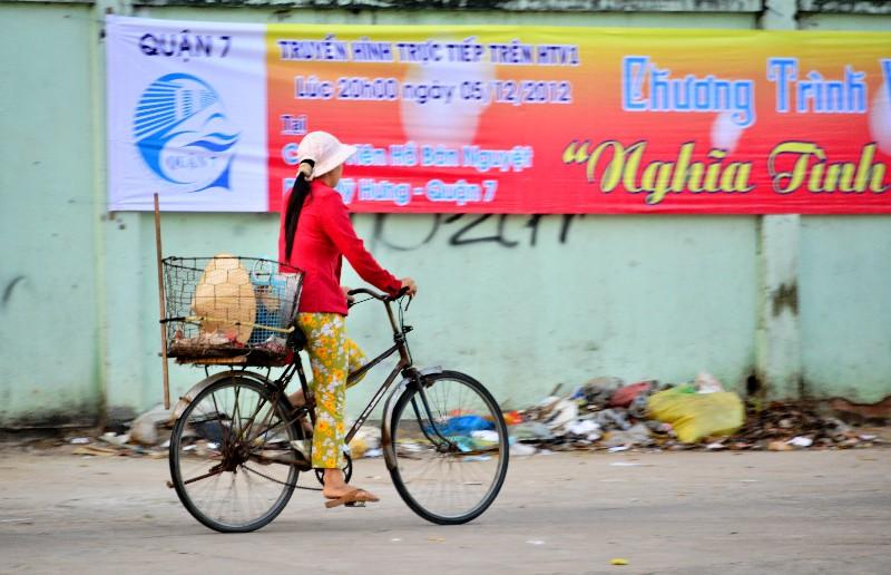crusing by trash, Nguyen Thi Thap street,  Saigon,  district 7, Vietnam