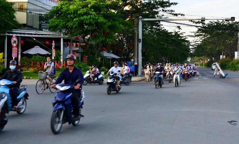 crossing Nguyen Van Linh street, Saigon, Vietnam