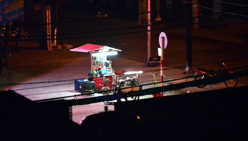 open all night, sleeping at intersection, Nguyen Thi Thap street, Saigon, Vietnam