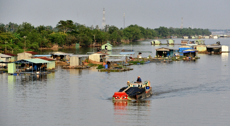 barge and fish farms, Mekong River,  Vietnam