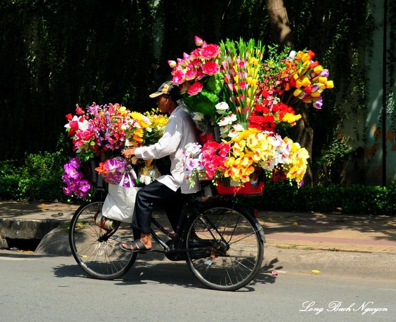 flowers delivery on bike, Saigon, Vietnam