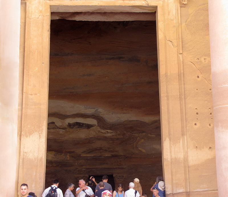 At the huge doorway, a glimpse of the interior