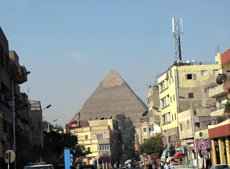 First sighting of Pyramid of Chefren (Khafre) from bus in Cairo suburb