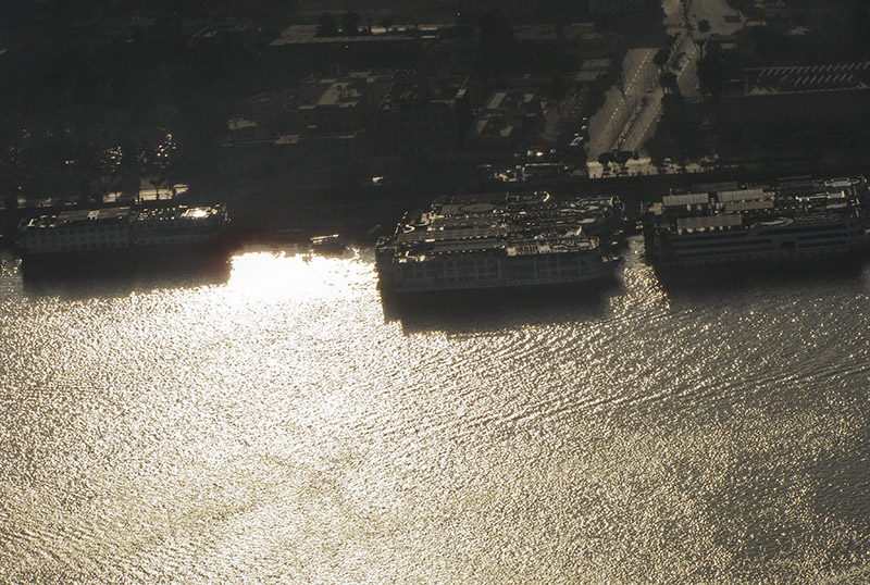 The cruise ships & river w/ more dramatic sunlight