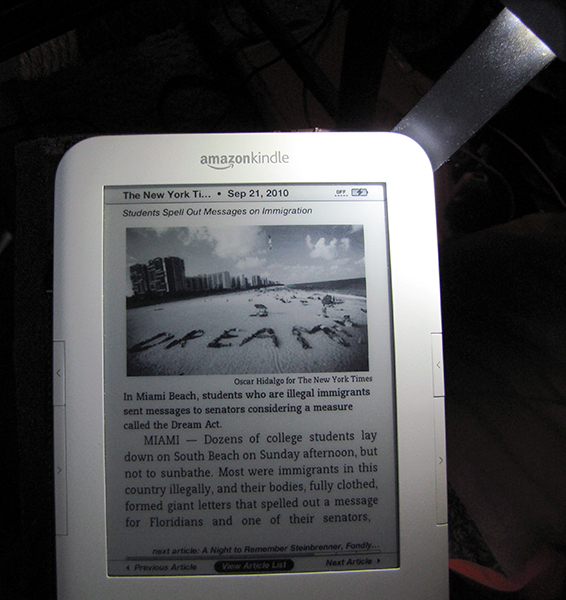 Kindle 3 lit by <a href=http://bit.ly/k3cvr-light target=_blank><u>cover w/ built-in light</u></a>