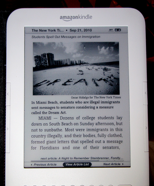 Kindle lit by <a href=http://amzn.to/beam-n-read3 target=_blank><u>Beam N Read light</u></a>