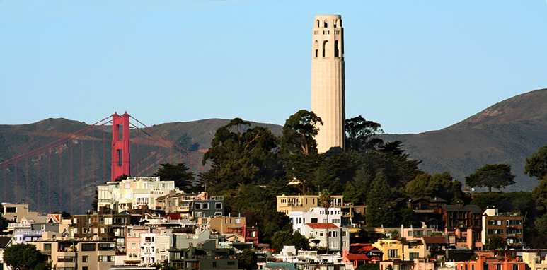 From moving car on Bay Bridge, the Golden Gate and Coit Tower