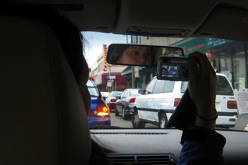 <a href=http://tinyurl.com/ycdum6 target=_blank>Dueling cameras</a>! at stop-light.  Click yellow link.