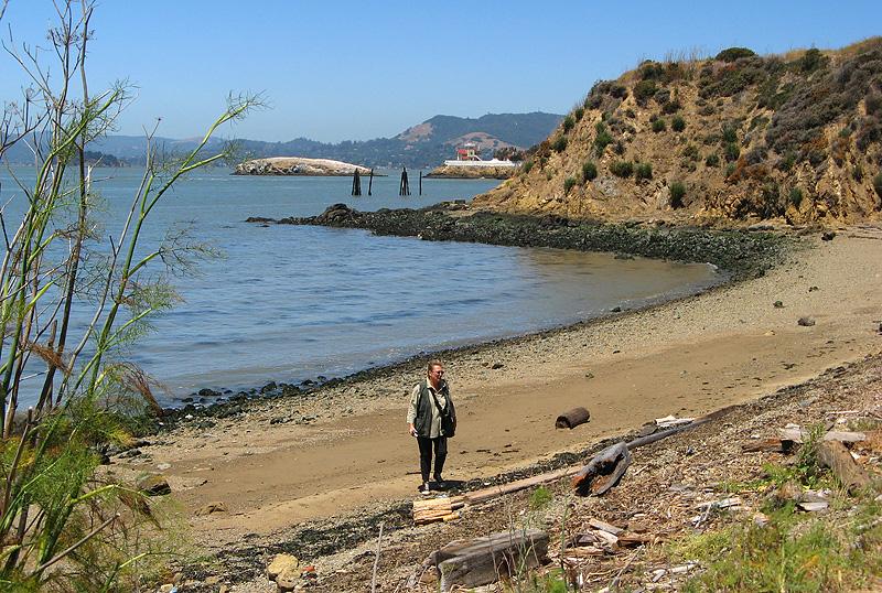 Karen exploring the unused beach