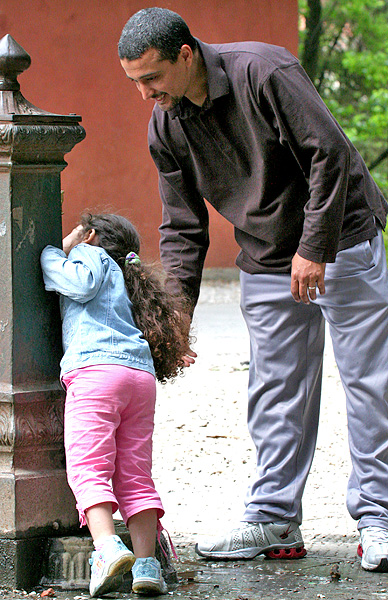 A simple pleasure for father and daughter at fountain