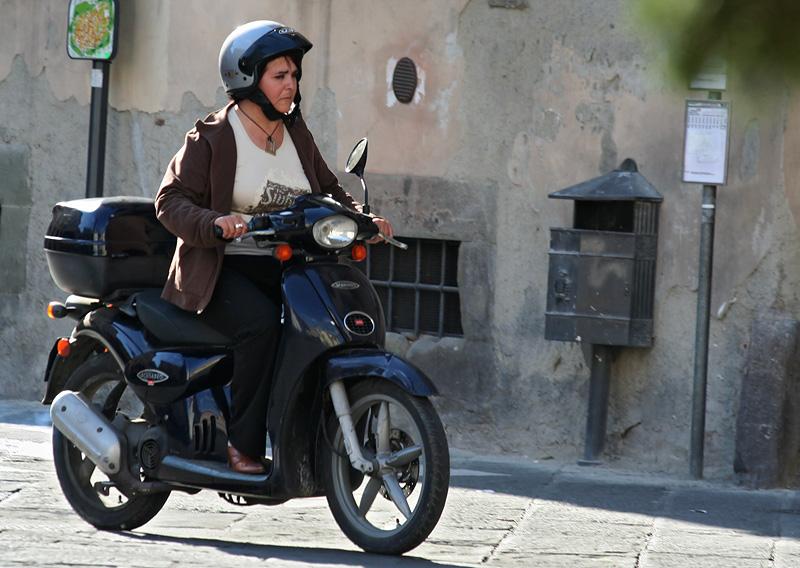 Serious biker, passing poles