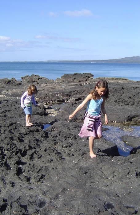 Hannah and Molly on the rocks at Takapuna