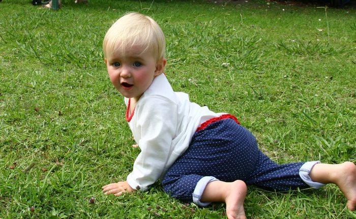 Charli crawliing in the Garden