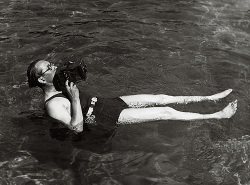 Martin Munkacsi, photographing for Harpers Bazaar in Long Island, taking an angle shot of a diver, 1935