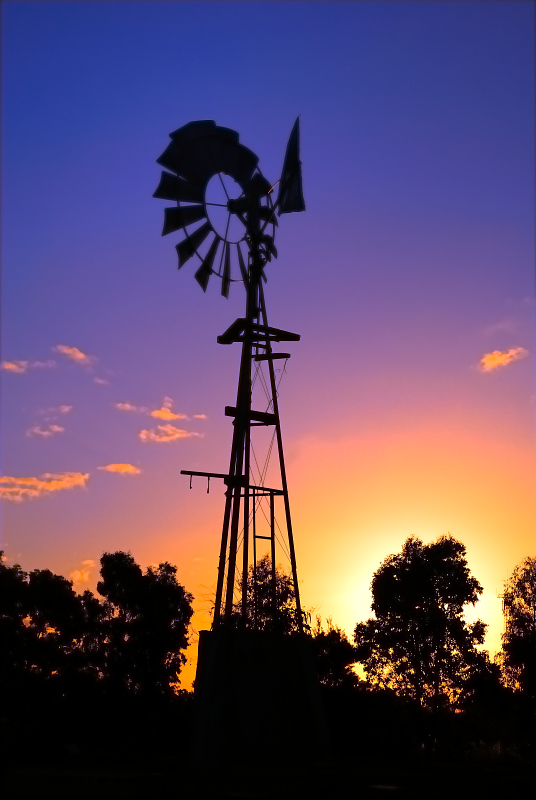 windmill in the setting sun