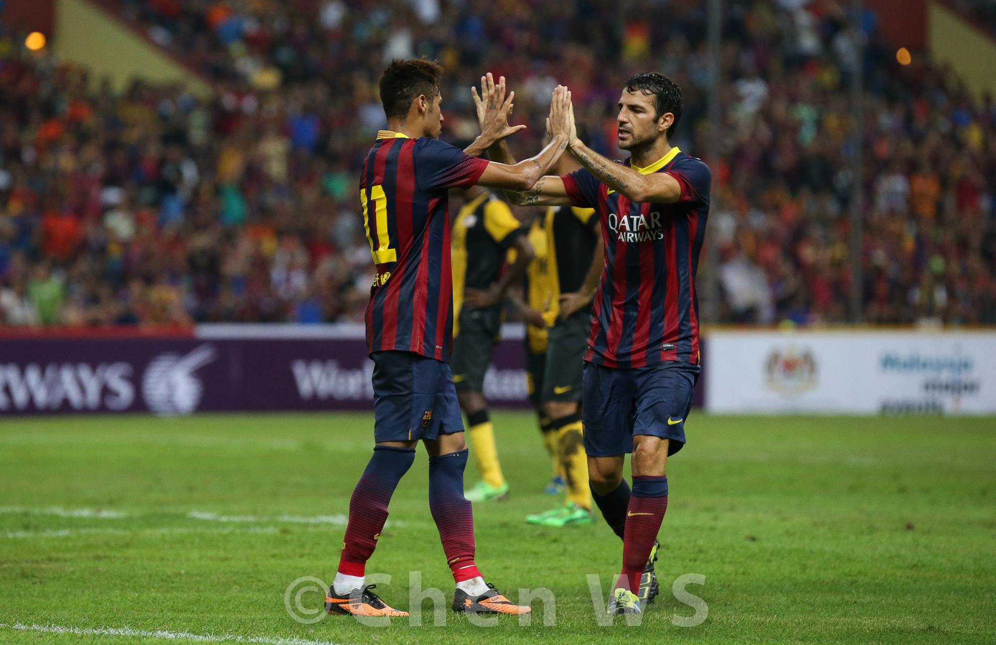 Neymar and Cesc Fabregas high five