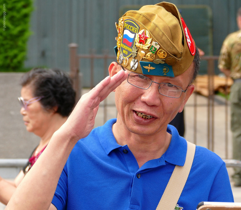 Red Square,Moscow. A Chinese tourist greets me with a Soviet army hat