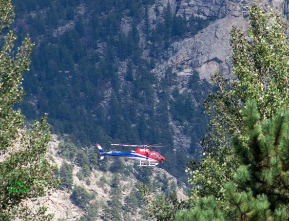 Helicopter crew seeks stranded people and evaluates Fish Creek flood damage - z P1090792
