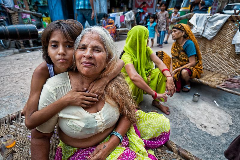 Girl hugs woman - Delhi