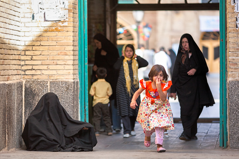 Iranian woman in chador begging