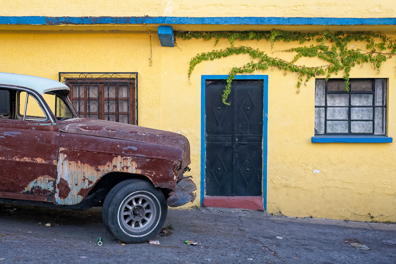 Old car yellow house