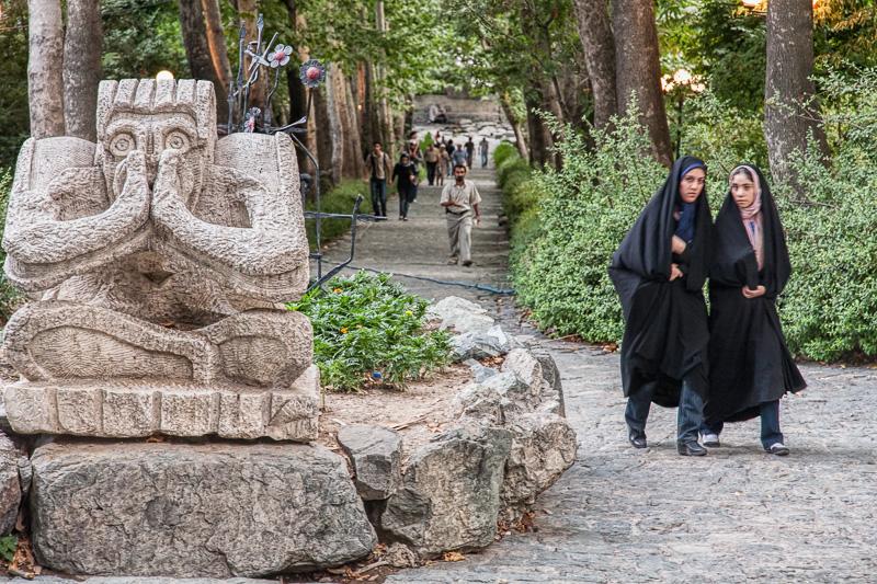 Women walking by sculpture - Tehran