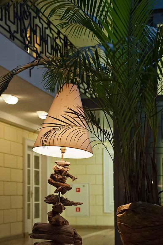 Lamp And Palm Leaves