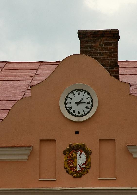 Clock Between Crest And Chimney