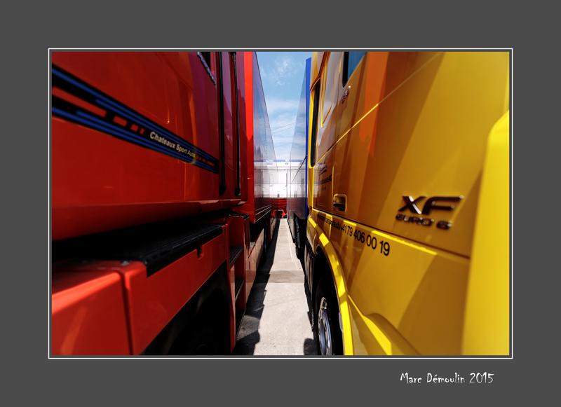 Between two trucks