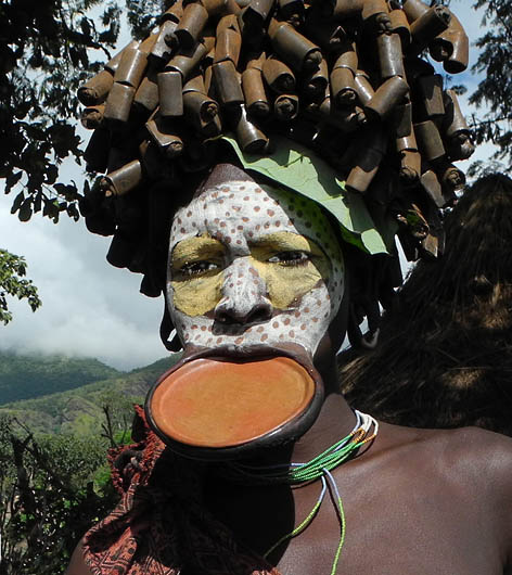 Surma woman with lip plate and decoration;  south-western Ethiopia.
