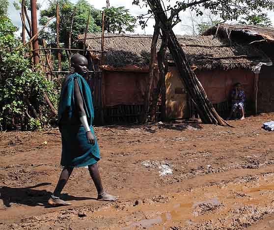 Surma woman on muddy road in Kibish;  south-western Ethiopia.