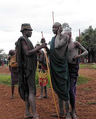 Surma men with white body paint;  south-western Ethiopia.