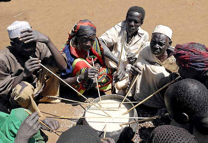 Komo tribals sharing a communal meal. Ethiopia.