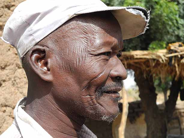 Scars identify this man as member of the Bobo tribe in Bana village, Burkina Faso