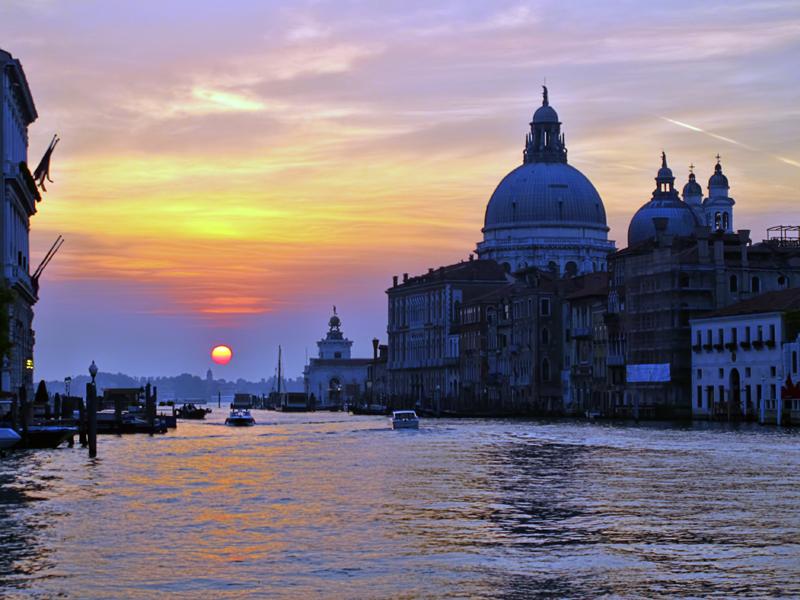 Rising sun in Venetian mist