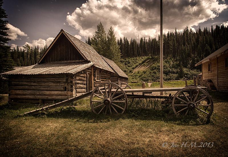 Old cabin and Buckboard