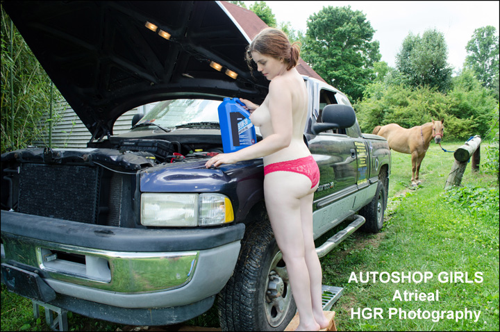 girl-working-on-truck-topless