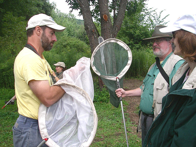 Tom shows Earle his catch