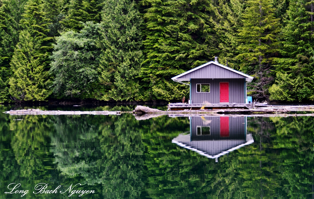 red door and blue,  floating cabin, Julia Passage, Vancouver Island, Canada