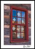 Old Salem Window with Cut Paper Snowflakes