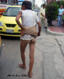 this woman walks her misery and  body  on the streets of Barranquilla