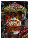 Colourful trishaws waiting for tourists
