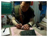 A craft man at work on the Gold Testing stones
