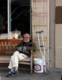 Old man with one crutch