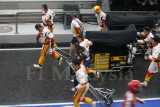 Pit crew running to the grid