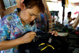 Hand-painted motif on camera bag, for 50 baht.