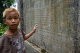Thai boy reading stone tablet at the peak