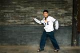 Hard rocker and a brick wall